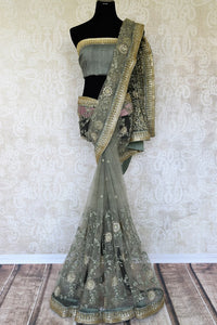 Experience the goodness of pastels and fancy drama with our exquisitely designed green net saree. The intricate tikki floral embroidery complemented with a gorgeous designer blouse is perfect for weddings and parties. Shop handloom sarees, georgette saris, printed sarees online or visit Pure Elegance store, USA. -full view