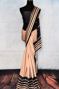 Buy stylish beige and black stonework crepe silk sari online in USA. The saree comes with a matching blouse piece. Add more such beautiful Indian designer sarees to your ethnic wardrobe from Pure Elegance exclusive Indian clothing store in USA or shop online.-full view