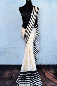 Buy stylish off-white and black stonework striped crepe silk sari online in USA. The saree comes with a matching black blouse piece. Add more such beautiful Indian designer saris to your ethnic wardrobe from Pure Elegance exclusive Indian clothing store in USA or shop online.-full view
