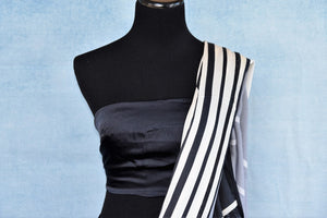 Buy stylish off-white and black stonework striped crepe silk sari online in USA. The saree comes with a matching black blouse piece. Add more such beautiful Indian designer saris to your ethnic wardrobe from Pure Elegance exclusive Indian clothing store in USA or shop online.-blouse pallu