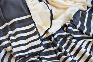 Buy stylish off-white and black stonework striped crepe silk sari online in USA. The saree comes with a matching black blouse piece. Add more such beautiful Indian designer saris to your ethnic wardrobe from Pure Elegance exclusive Indian clothing store in USA or shop online.-details