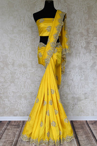 The dreamy yellow crepe silk sari is crafted with authentic silk and embroidered all over. Doll up traditional in this elegant statement saree with a matching designer blouse. Shop handwoven silk sarees, embroidered designer saris online or visit Pure Elegance store in USA. -full view