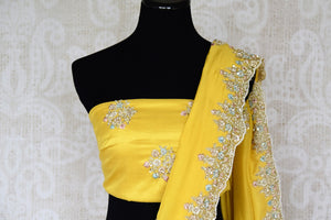 The dreamy yellow crepe silk sari is crafted with authentic silk and embroidered all over. Doll up traditional in this elegant statement saree with a matching designer blouse. Shop handwoven silk sarees, embroidered designer saris online or visit Pure Elegance store in USA. -blouse pallu