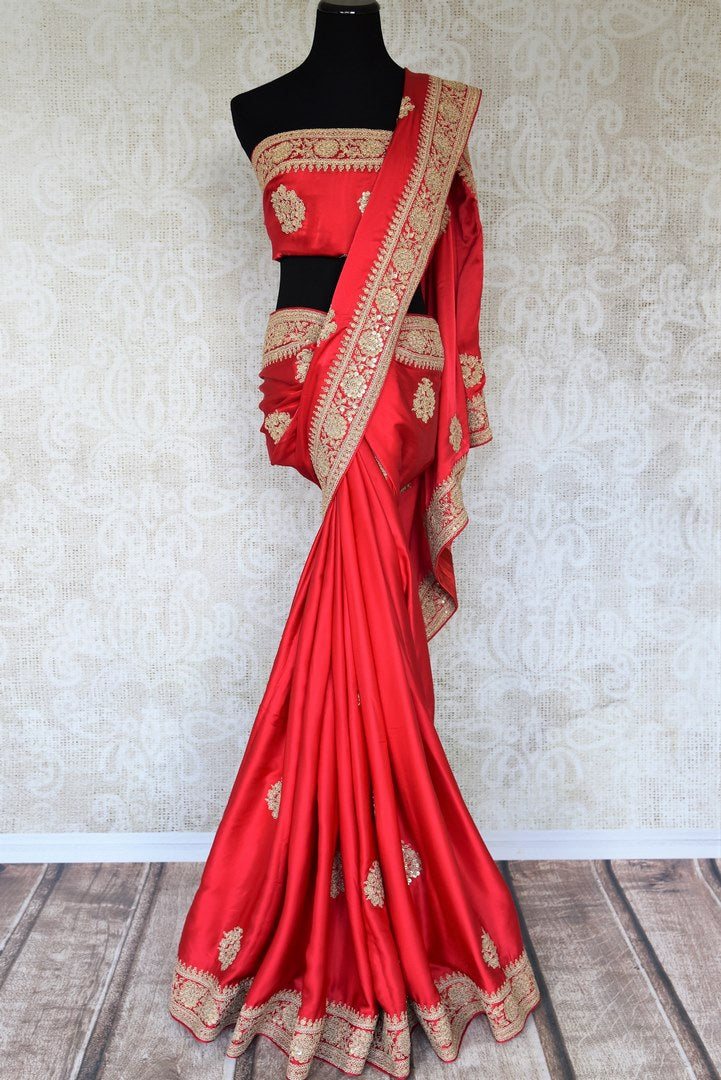 Shop this bridal red crepe silk traditional saree with intricate zardozi work. The signature zari woven blouse enhances the overall look and exudes beauty at par. Shop handloom sarees, designer silk saris, ikkat sarees, online or visit Pure Elegance store in USA. -full view