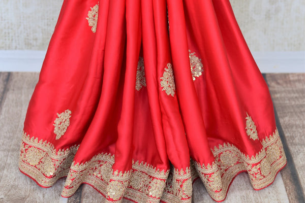 Shop this bridal red crepe silk traditional saree with intricate zardozi work. The signature zari woven blouse enhances the overall look and exudes beauty at par. Shop handloom sarees, designer silk saris, ikkat sarees, online or visit Pure Elegance store in USA. -pleats