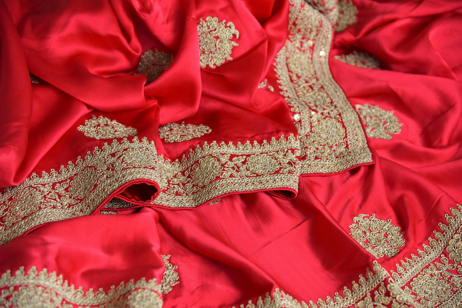 Shop this bridal red crepe silk traditional saree with intricate zardozi work. The signature zari woven blouse enhances the overall look and exudes beauty at par. Shop handloom sarees, designer silk saris, ikkat sarees, online or visit Pure Elegance store in USA. -details