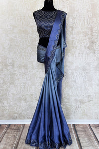 Buy elegant blue crepe silk designer sari online in USA with Swarovski stonework. The saree comes with a designer saree blouse perfect for a dazzling party look. Spoil yourself with an exquisite collection of Indian designer sarees in USA available at Pure Elegance Indian clothing store. -full view