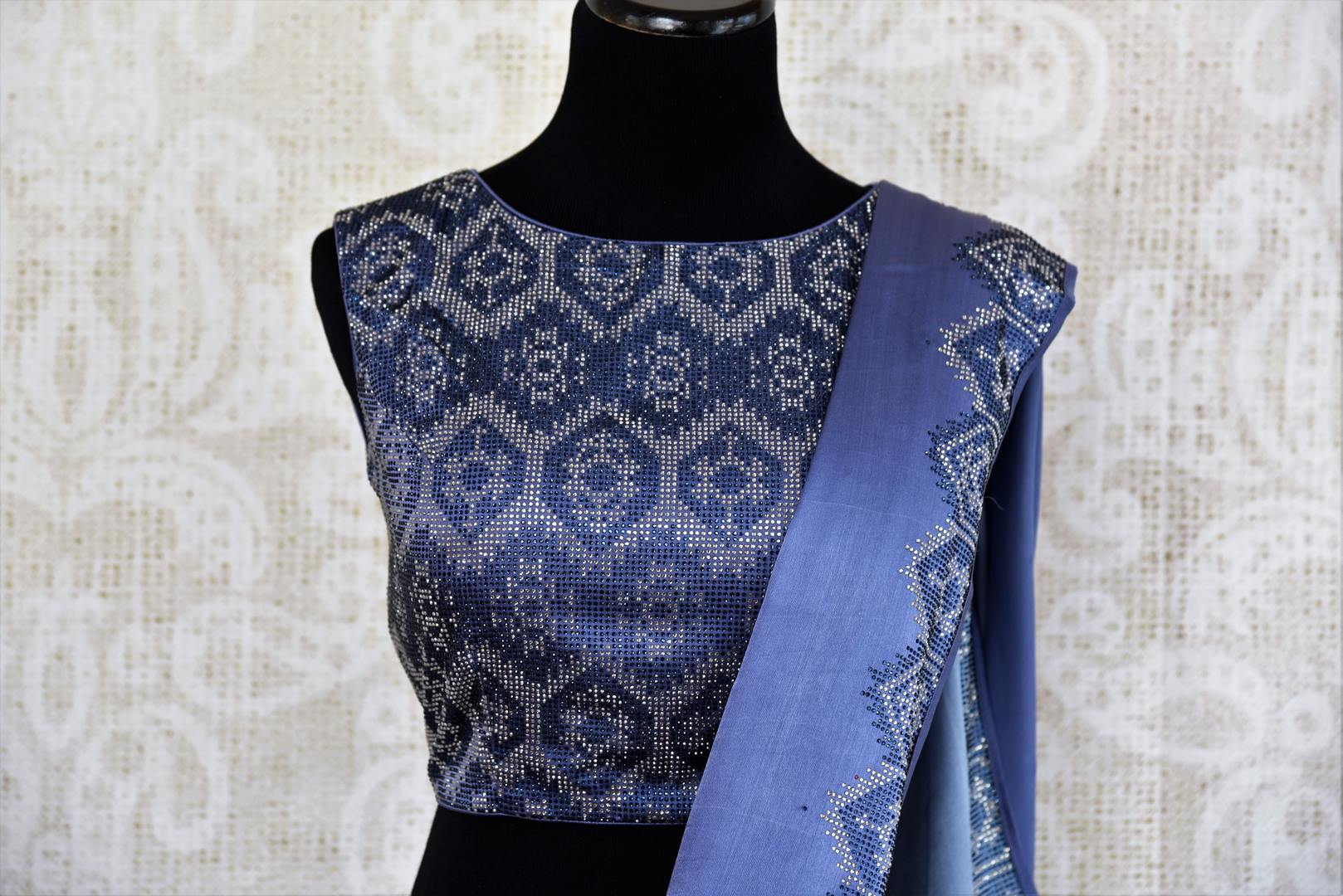 Buy elegant blue crepe silk designer sari online in USA with Swarovski stonework. The saree comes with a designer saree blouse perfect for a dazzling party look. Spoil yourself with an exquisite collection of Indian designer sarees in USA available at Pure Elegance Indian clothing store. -blouse pallu