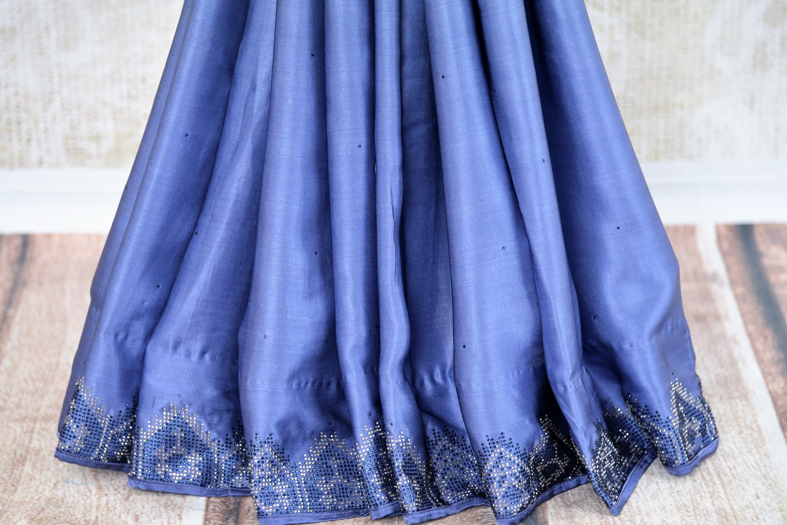 Buy elegant blue crepe silk designer sari online in USA with Swarovski stonework. The saree comes with a designer saree blouse perfect for a dazzling party look. Spoil yourself with an exquisite collection of Indian designer sarees in USA available at Pure Elegance Indian clothing store. -pleats