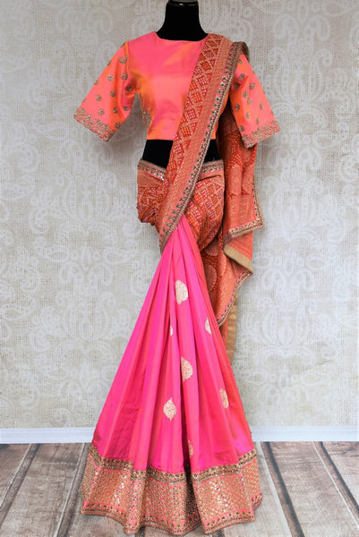 Buy pink and red Banarasi khaddi saree with embroidered blouse online in USA . Beautifully designed saree is a captivating choice for weddings and parties. Shop Indian wedding sarees in USA from an alluring collection available at Pure Elegance fashion store.-full view
