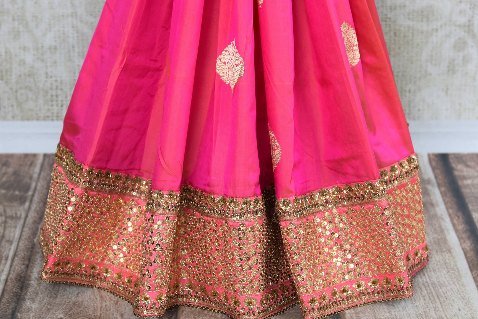 Buy pink and red Banarasi khaddi saree with embroidered blouse online in USA . Beautifully designed saree is a captivating choice for weddings and parties. Shop Indian wedding sarees in USA from an alluring collection available at Pure Elegance fashion store.-pleats