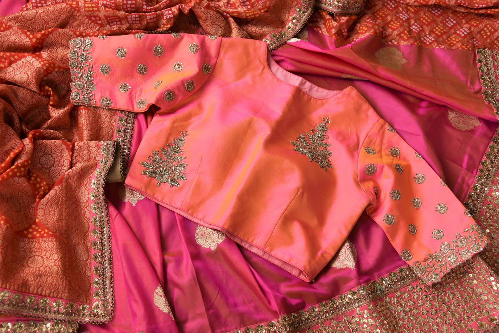 Buy pink and red Banarasi khaddi saree with embroidered blouse online in USA . Beautifully designed saree is a captivating choice for weddings and parties. Shop Indian wedding sarees in USA from an alluring collection available at Pure Elegance fashion store.-details