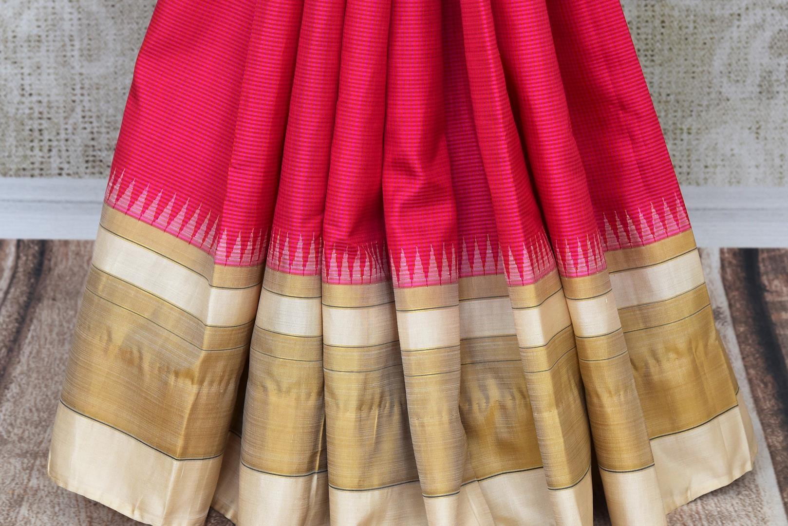 Elegant pink Kanjivaram silk saree buy online in USA. It comes with an embroidered saree blouse to elevate your Indian sari look. If you are looking for Indian designer silk sarees in USA, then Pure Elegance clothing store is your one-stop solution, shop now.-pleats