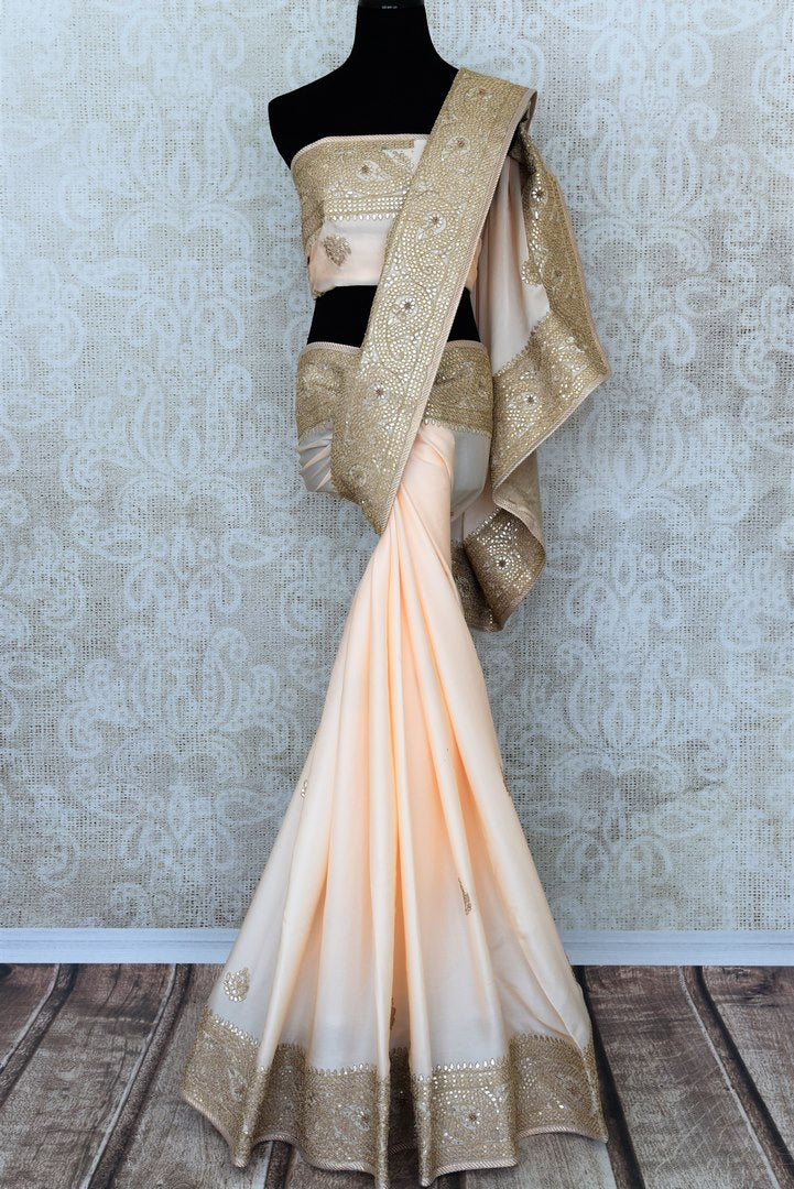 Beautiful cream gota patti embroidered crepe saree buy online in USA.  If you are looking for Indian designer wedding sarees in USA, then Pure Elegance clothing store is your one-stop solution, shop now.-full view