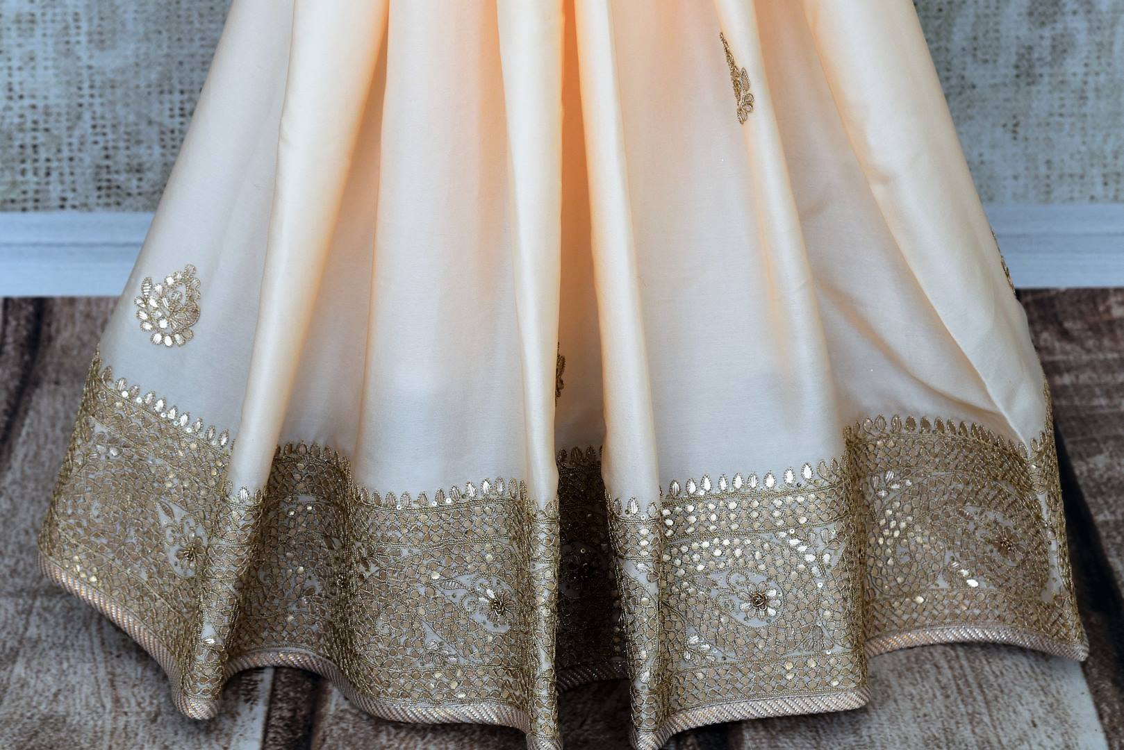 Beautiful cream gota patti embroidered crepe saree buy online in USA.  If you are looking for Indian designer wedding sarees in USA, then Pure Elegance clothing store is your one-stop solution, shop now.-pleats