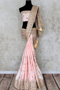 Beautiful peach hand zardozi embroidery crepe saree buy online in USA.  If you are looking for Indian designer wedding saris in USA, then Pure Elegance clothing store is your one-stop solution, shop now.-full view
