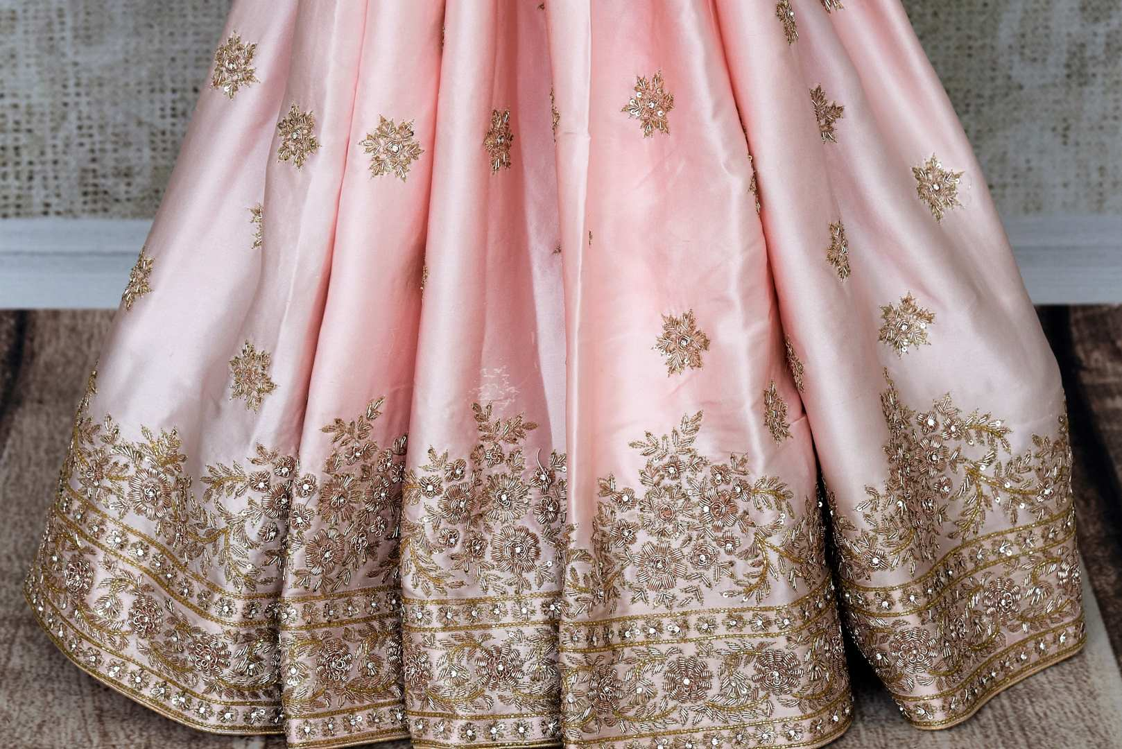 Beautiful peach hand zardozi embroidery crepe saree buy online in USA.  If you are looking for Indian designer wedding saris in USA, then Pure Elegance clothing store is your one-stop solution, shop now.-pleats