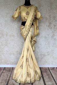 Meticulously crafted crepe silk sari, this designer white sari with intricate zardozi embroidery is indeed a spectacular piece. It comes with a designer embroidered blouse and a rich pallu, perfect for weddings. Shop handloom sarees, banarsi silk saris, crepe silk saris online or visit Pure Elegance store in USA. -full view