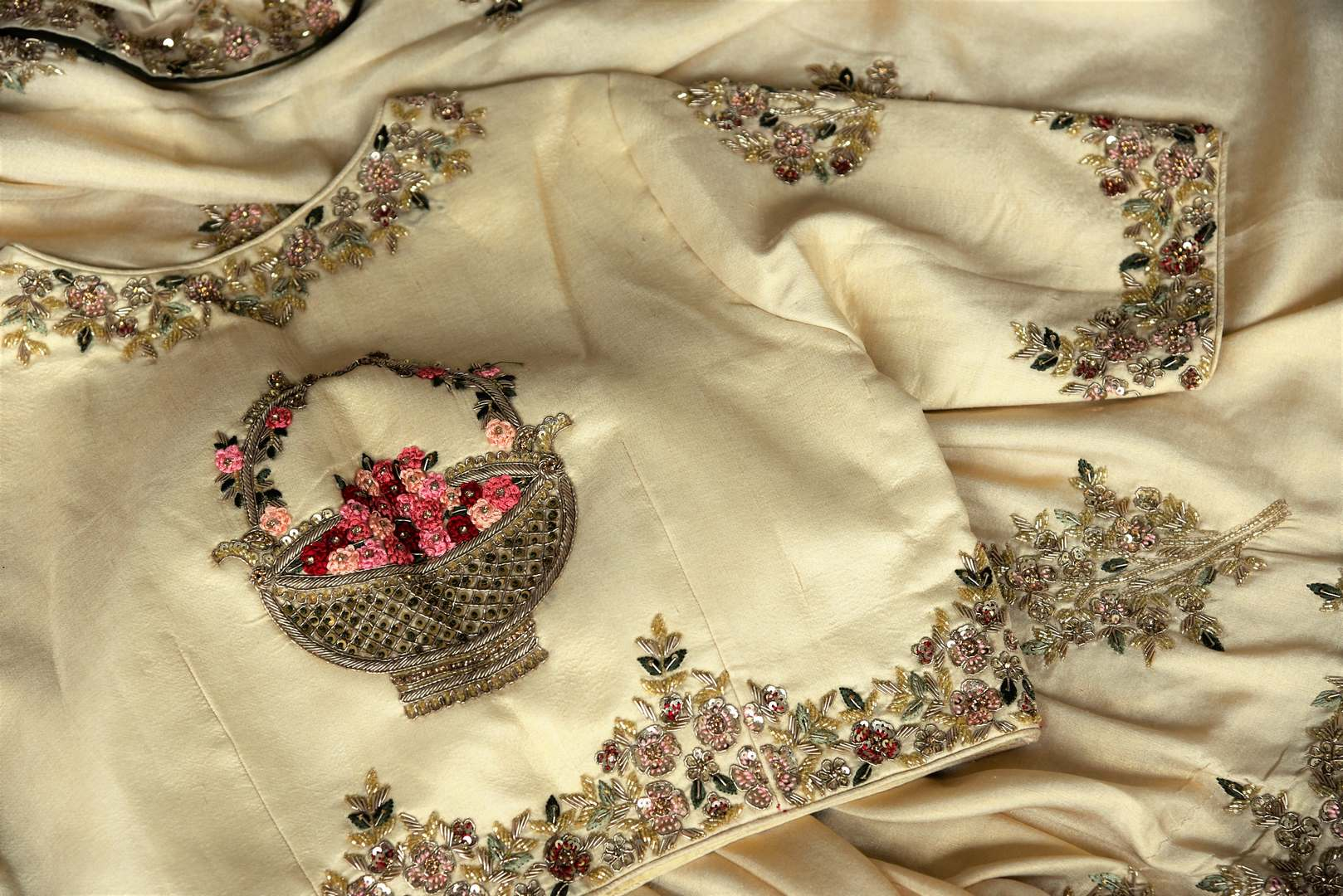 Meticulously crafted crepe silk sari, this designer white sari with intricate zardozi embroidery is indeed a spectacular piece. It comes with a designer embroidered blouse and a rich pallu, perfect for weddings. Shop handloom sarees, banarsi silk saris, crepe silk saris online or visit Pure Elegance store in USA. -details