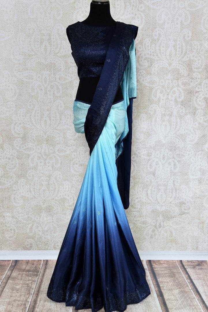Buy elegant ombre blue crepe silk sari online in USA with Swarovski work. The saree is a beautiful drape for a stylish party look. Find more such exquisite Indian designer sarees in USA at Pure Elegance Indian fashion store. Shop now.-full view