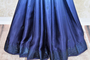 Buy elegant ombre blue crepe silk sari online in USA with Swarovski work. The saree is a beautiful drape for a stylish party look. Find more such exquisite Indian designer sarees in USA at Pure Elegance Indian fashion store. Shop now.-pleats