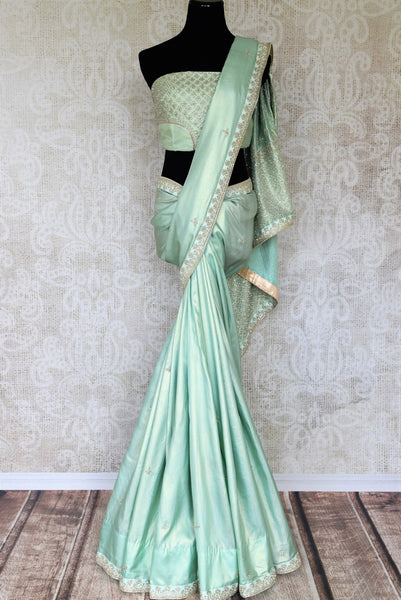 Shop this celebrity-inspired pastel green simmer georgette designer saree to make a statement at parties and special events. Comes with a designer blouse, it is perfect for summer soiree. Shop designer silk sarees, georgette saris, handloom sarees online or visit Pure Elegance store in USA. -full view