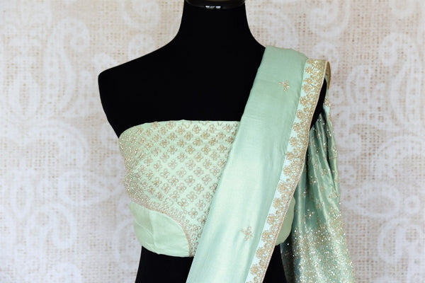 Shop this celebrity-inspired pastel green simmer georgette designer saree to make a statement at parties and special events. Comes with a designer blouse, it is perfect for summer soiree. Shop designer silk sarees, georgette saris, handloom sarees online or visit Pure Elegance store in USA. -blouse pallu