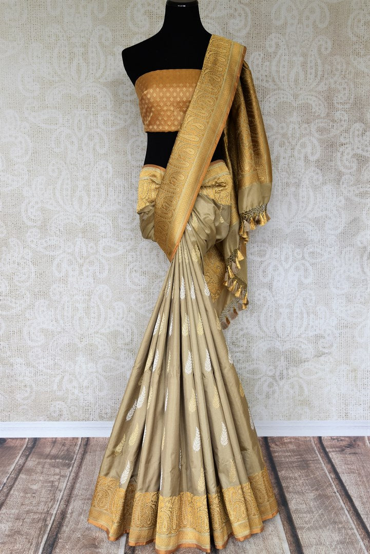 Celebrate festivals and weddings in our modern infused traditional cream banarsi silk saree hand woven to exude perfection and class. The gorgeous ethnic ensemble is handcrafted with authentic and rich silk weaves. Shop designer silk sarees, Indian dresses, handloom saris online or visit Pure Elegance, USA. -full view
