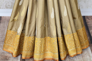 Celebrate festivals and weddings in our modern infused traditional cream banarsi silk saree hand woven to exude perfection and class. The gorgeous ethnic ensemble is handcrafted with authentic and rich silk weaves. Shop designer silk sarees, Indian dresses, handloom saris online or visit Pure Elegance, USA. -pleats