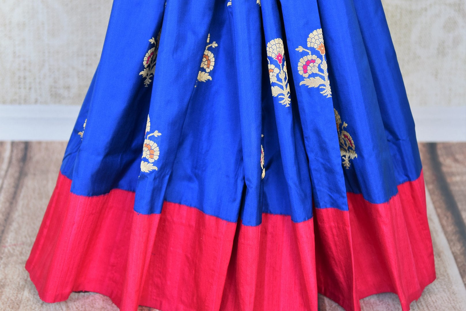 Traditional blue Banarasi silk sari buy online in USA with zari buta. The saree is sure to bring richness to your Indian ethnic look. If you are looking for Indian designer silk sarees, Banarasi sarees in USA, then Pure Elegance clothing store is your one-stop solution, shop now.-pleats