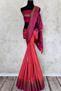 Buy orange tussar katan Banarasi sari online in USA with antique zari border. The saree is a perfect traditional drape for parties and festivals. Spoil yourself with an exquisite collection of Indian Banarasi sarees in USA available at Pure Elegance Indian clothing store. -full view