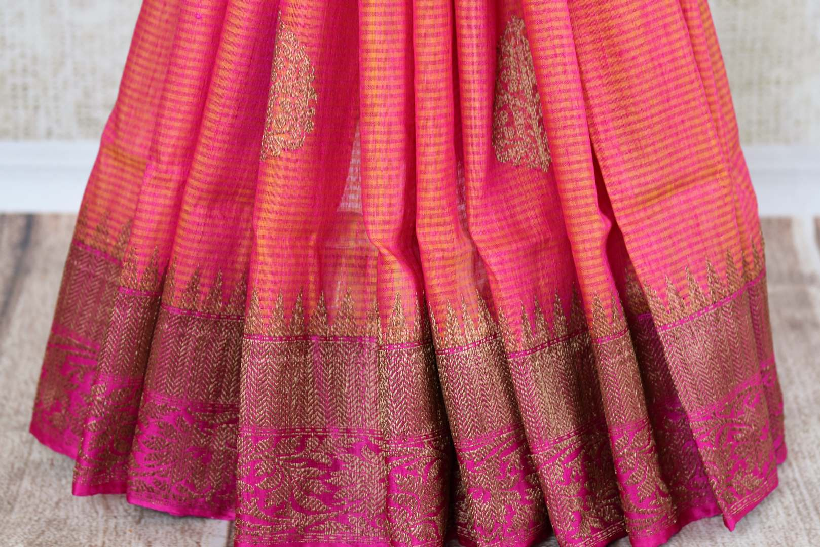 Buy orange tussar katan Banarasi sari online in USA with antique zari border. The saree is a perfect traditional drape for parties and festivals. Spoil yourself with an exquisite collection of Indian Banarasi sarees in USA available at Pure Elegance Indian clothing store. -pleats