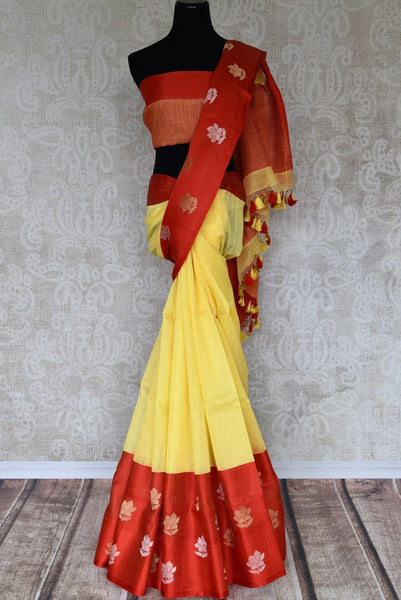 Elevate your style in this yellow cotton banarsi silk saree with a graceful red satin border. The perfect party saree with a winning combination is sure to bring you compliments. It comes with a red contrasting blouse. Shop handloom sarees, silk sarees, designer saris online or visit Pure Elegance store, USA. -full view