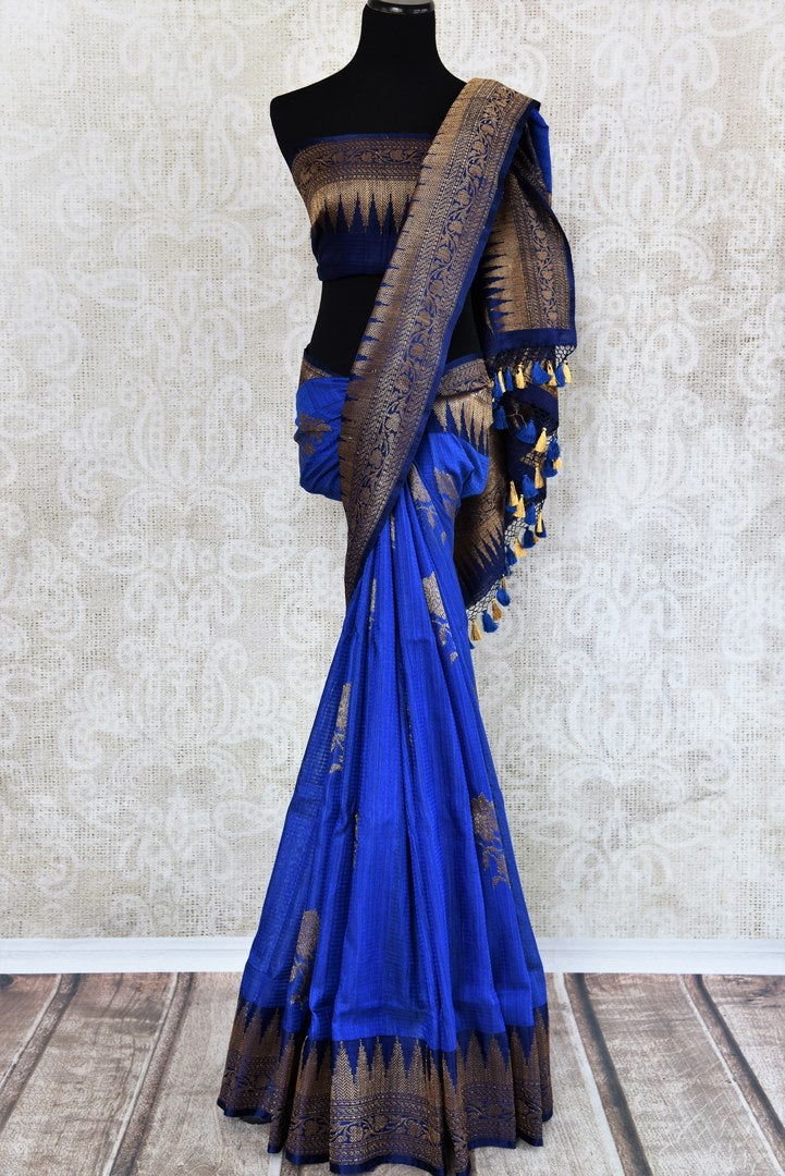 Buy traditional ink blue tussar katan Banarasi saree online in USA with zari border. The saree is a perfect drape for a rich ethnic Indian look. Spoil yourself with an exquisite collection of Indian Banarasi saris in USA available at Pure Elegance Indian clothing store. -full view