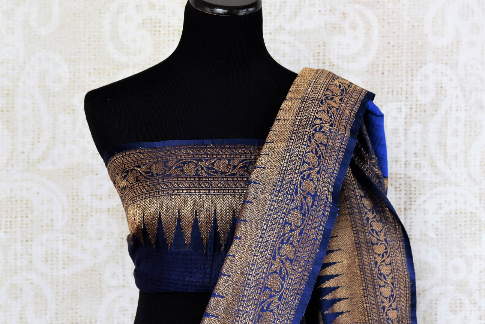 Buy traditional ink blue tussar katan Banarasi saree online in USA with zari border. The saree is a perfect drape for a rich ethnic Indian look. Spoil yourself with an exquisite collection of Indian Banarasi saris in USA available at Pure Elegance Indian clothing store. -blouse pallu