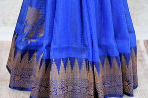 Buy traditional ink blue tussar katan Banarasi saree online in USA with zari border. The saree is a perfect drape for a rich ethnic Indian look. Spoil yourself with an exquisite collection of Indian Banarasi saris in USA available at Pure Elegance Indian clothing store. -pleats