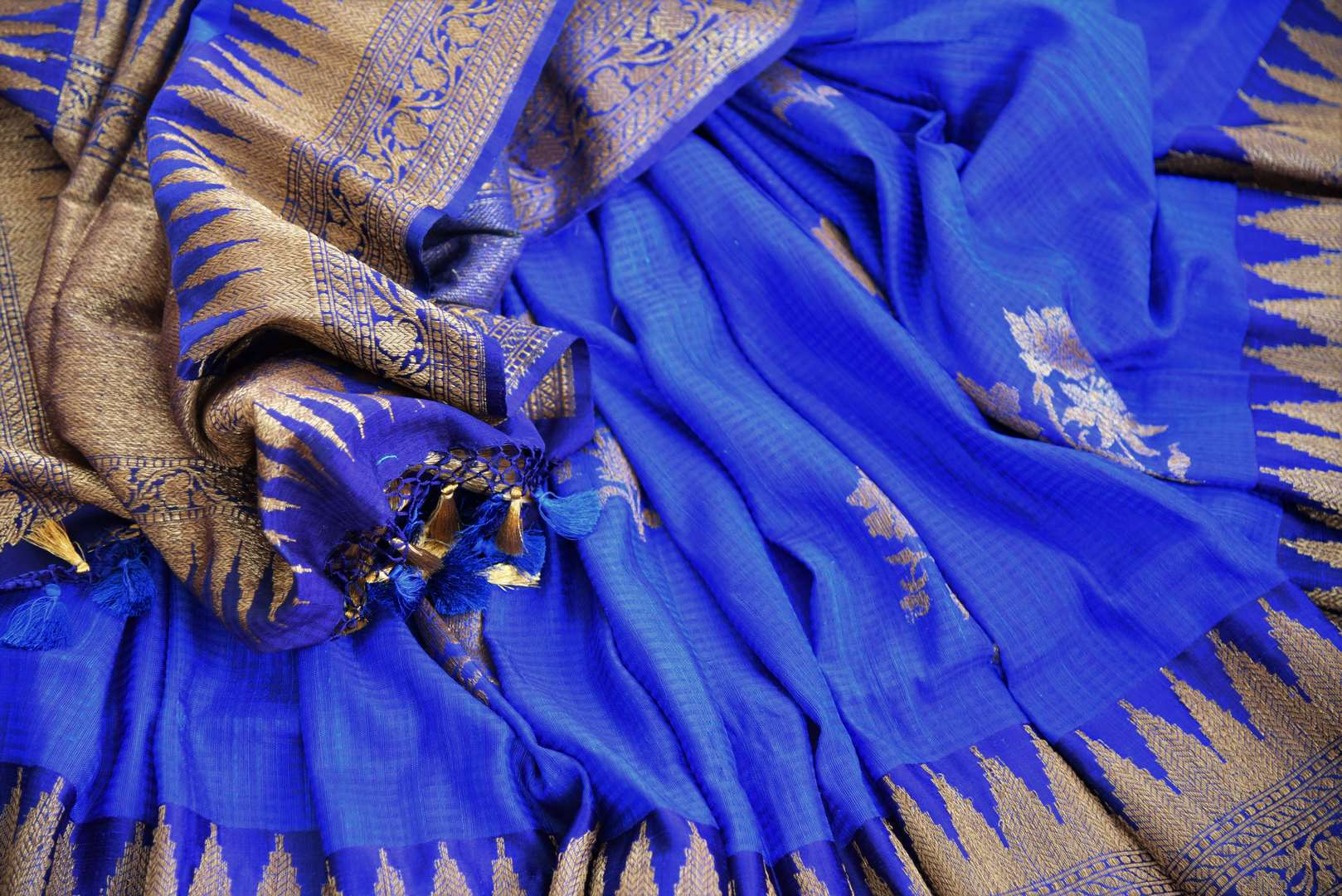 Buy traditional ink blue tussar katan Banarasi saree online in USA with zari border. The saree is a perfect drape for a rich ethnic Indian look. Spoil yourself with an exquisite collection of Indian Banarasi saris in USA available at Pure Elegance Indian clothing store. -details