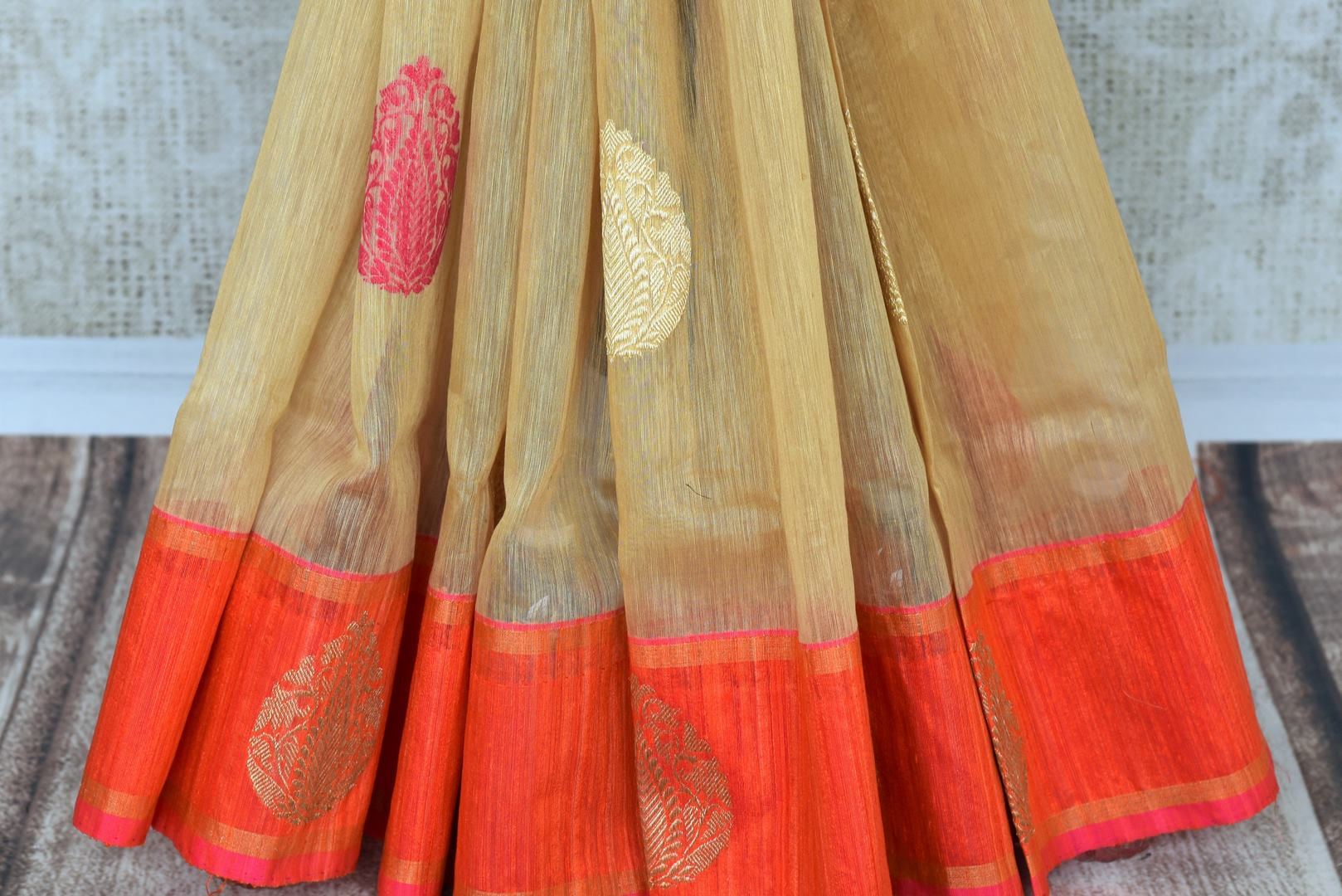 Shop beautiful beige Kora Banarasi saree online in USA with zari buta. Make your ethnic wardrobe rich with traditional Indian Banarasi saris available at Pure Elegance exclusive clothing store in USA or shop online.-pleats