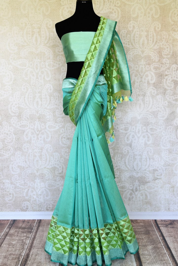 Emanate elegance in this sartorial designer pastel green jute banarsi silk sari with subtle pyramid embroidery on the hem and the pallu. The effervescent silk saree is paired with a dazzling green blouse. Shop such designer silk saris, ikkat sarees, printed saris online or visit Pure Elegance store in USA.-full view