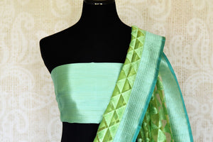 Emanate elegance in this sartorial designer pastel green jute banarsi silk sari with subtle pyramid embroidery on the hem and the pallu. The effervescent silk saree is paired with a dazzling green blouse. Shop such designer silk saris, ikkat sarees, printed saris online or visit Pure Elegance store in USA.-blouse pallu