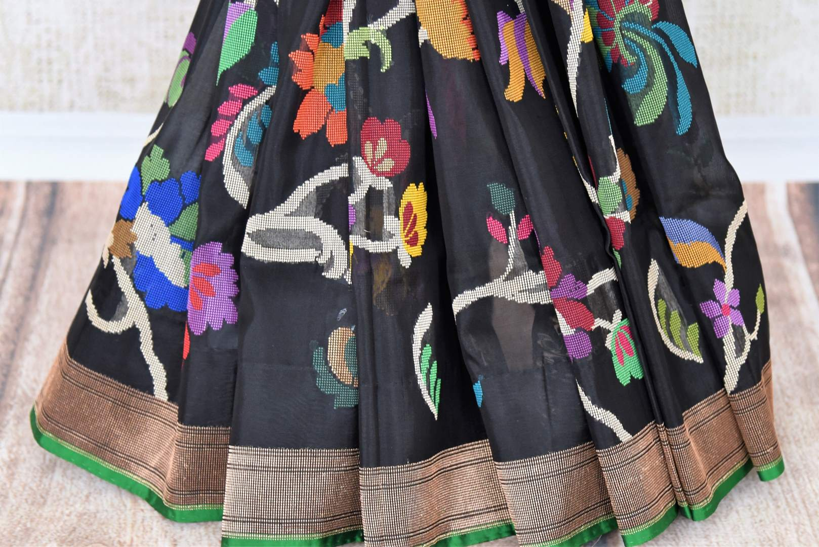 Shop elegant black kora tissue silk saree online in USA with dull gold border. Make your ethnic wardrobe rich with traditional Indian silk saris available at Pure Elegance exclusive clothing store in USA or shop online.-pleats