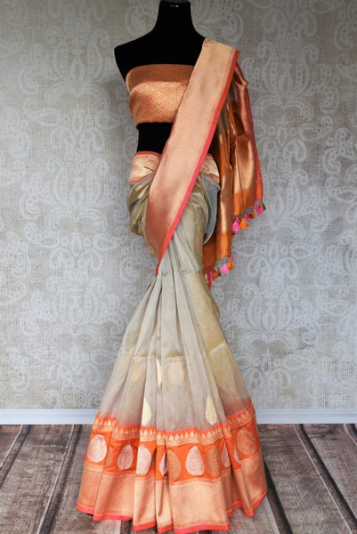 Invest in rich designer tissue and banarsi silk blended sari online with buta work and heavy pallu. Sashay at royal parties and celebrate weddings in this exquisitely designed Indian sari with modern tassels hanging on pallu. Shop beautiful designer sarees, georgette saris online or visit Pure Elegance store in USA. -full view