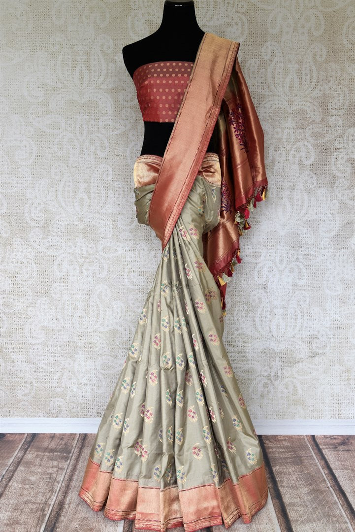 Escalate debonair lady in you with our exquisitely designer grey banarsi silk saree. Style this sari with a red buta work blouse complimented with heavy red pallu to up your style quotient. Shop such designer printed saree, embroidered sari, kanjeevaram silk sari online or visit the Pure Elegance store in USA. -full view