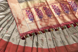 Escalate debonair lady in you with our exquisitely designer grey banarsi silk saree. Style this sari with a red buta work blouse complimented with heavy red pallu to up your style quotient. Shop such designer printed saree, embroidered sari, kanjeevaram silk sari online or visit the Pure Elegance store in USA. -details