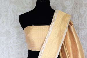 Adorn the beauty of this designer cream tissue banarsi sik saree. Style this breath-taking silk sari with a gold designer blouse complimented with gold pallu. Shop designer silk saris, kalamkari sarees, banarasi silk saris online or visit Pure Elegance store in USA.-blouse pallu