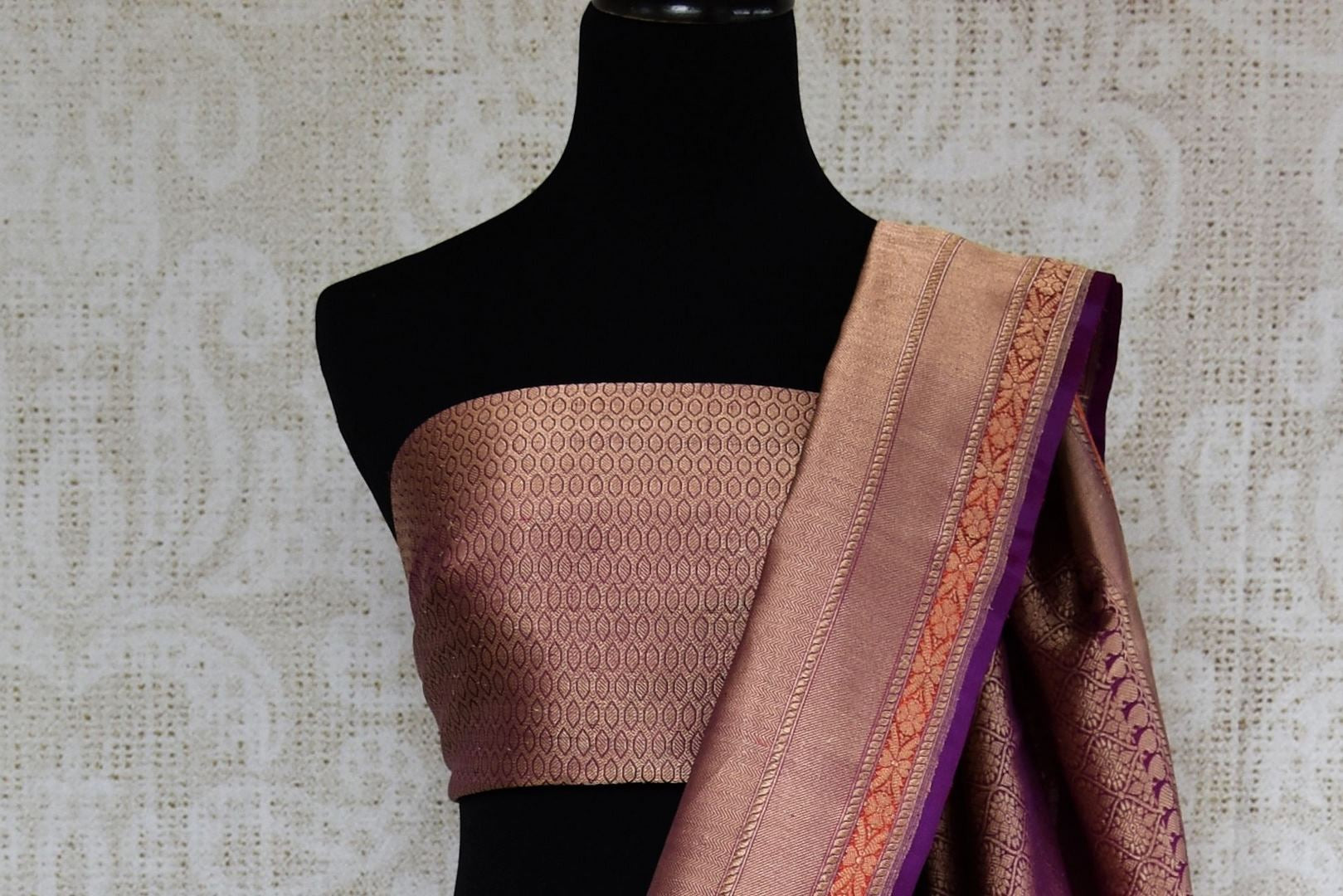 Buy online traditional orange Banarasi silk sari with buta online in USA and purple zari border. The saree is a beautiful drape for an ethnic Indian look at weddings and special occasions. Find more such exquisite Indian silk sarees, handloom sarees in USA at Pure Elegance Indian fashion store. Shop now.-blouse pallu