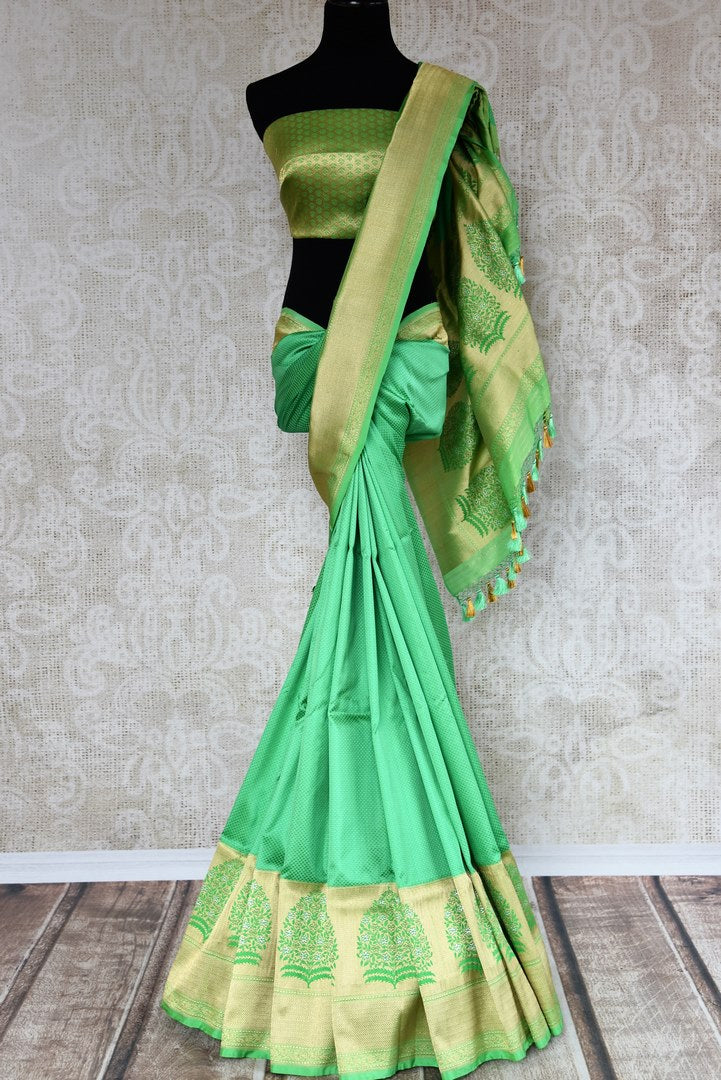Buy beautiful green Banarasi silk saree online in USA with golden border. The saree is a classic choice for parties and special occasions. For Indian women in USA, Pure Elegance brings a range of stunning Indian designer silk saris online and at their exclusive fashion store in USA.-full view