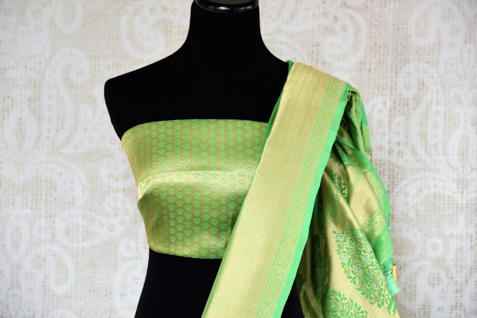 Buy beautiful green Banarasi silk saree online in USA with golden border. The saree is a classic choice for parties and special occasions. For Indian women in USA, Pure Elegance brings a range of stunning Indian designer silk saris online and at their exclusive fashion store in USA.-blouse pallu
