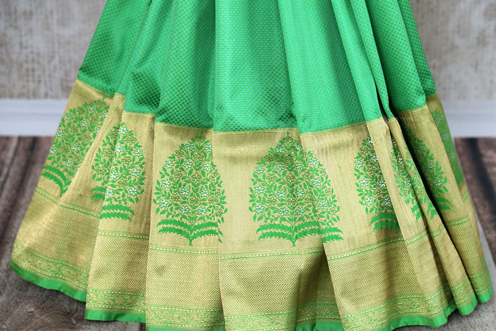 Buy beautiful green Banarasi silk saree online in USA with golden border. The saree is a classic choice for parties and special occasions. For Indian women in USA, Pure Elegance brings a range of stunning Indian designer silk saris online and at their exclusive fashion store in USA.-pleats