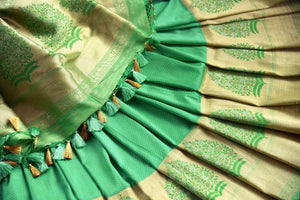 Buy beautiful green Banarasi silk saree online in USA with golden border. The saree is a classic choice for parties and special occasions. For Indian women in USA, Pure Elegance brings a range of stunning Indian designer silk saris online and at their exclusive fashion store in USA.-details